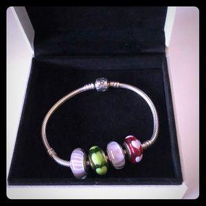 Authentic Pandora 7.25 bracelet with 4 charms.